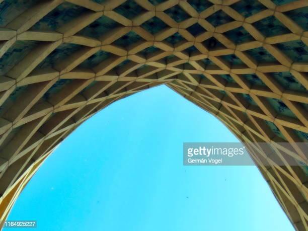blue sky arch under tehran landmark azadi tower - tehran stock pictures, royalty-free photos & images