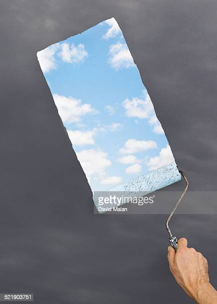 Blue sky being painted over grey sky