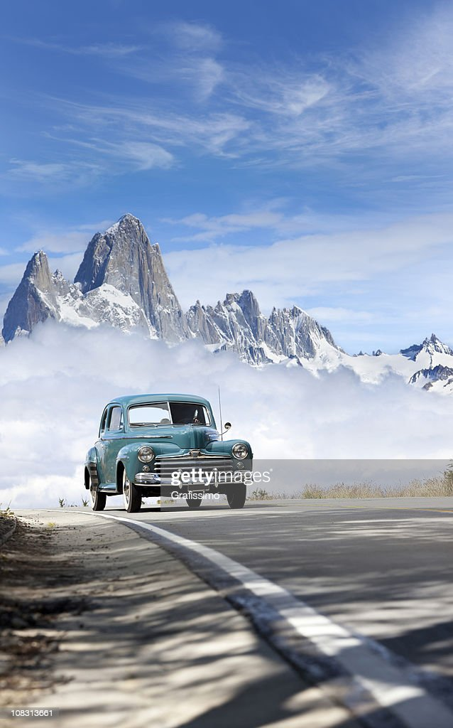 Blue sky over antique car driving in Patagonia Argentina : Stock Photo
