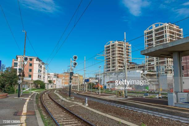 blue sky over empty railway track in city, italy - image foto e immagini stock