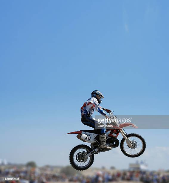 blue sky over flying motorbike - stunt person stock photos and pictures