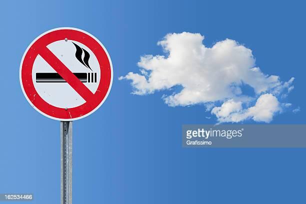 Blue sky over no smoking traffic sign