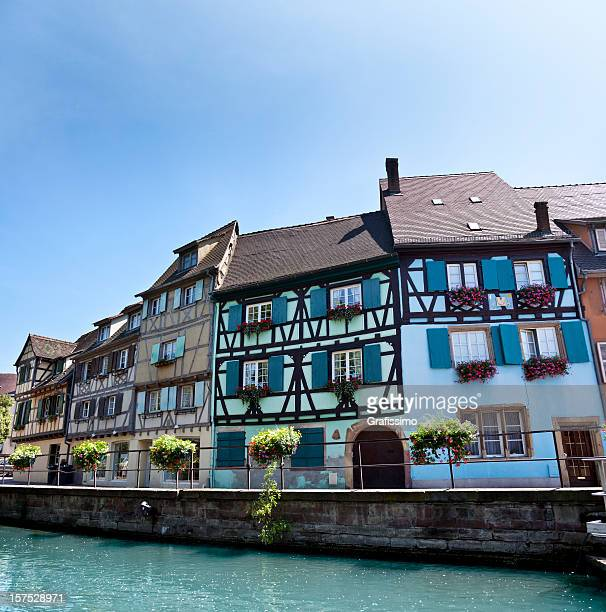 blue sky over old town of colmar in france - colmar stock photos and pictures