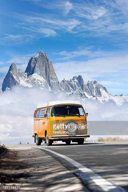 blue sky over orange volkswagen mini van - volkswagen stock pictures, royalty-free photos & images