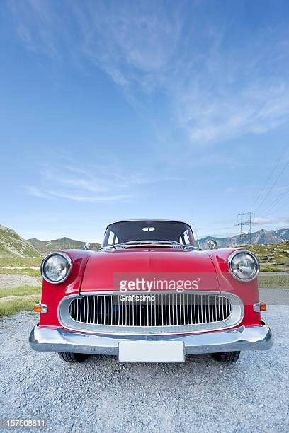 Blue sky over red oldtimer car