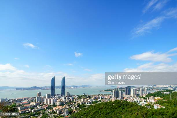 blue sky over seaside city, xiamen, fujian, china - xiamen fotografías e imágenes de stock