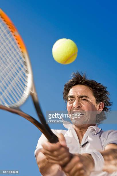 blue sky over tennis player hitting the ball - match point scoring stock pictures, royalty-free photos & images