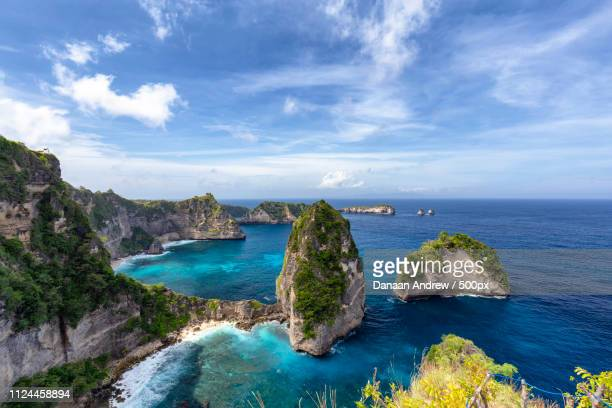 blue sky over the raja lima islands - regency style stock photos and pictures