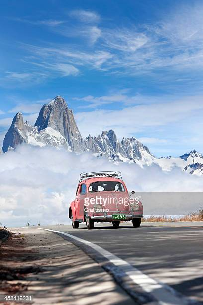 blue sky over volkswagen beetle in patagonia argentina - volkswagen beetle stock photos and pictures