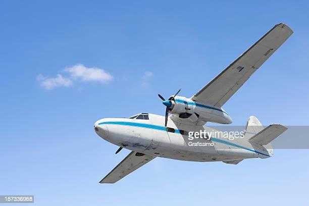 Blue sky over white propeller plane