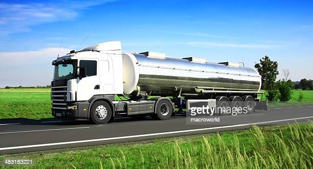 blue sky over white truck - storage tank stock photos and pictures