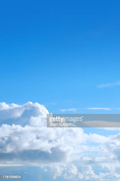 blue sky puffy cloud - blue stock pictures, royalty-free photos & images