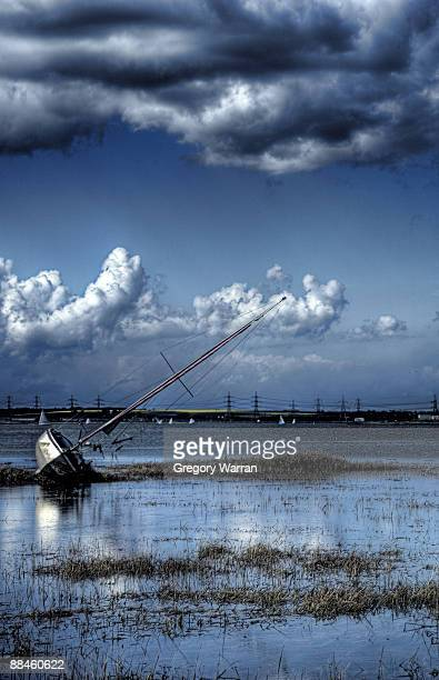 blue sky reflected in river  - river medway stock photos and pictures