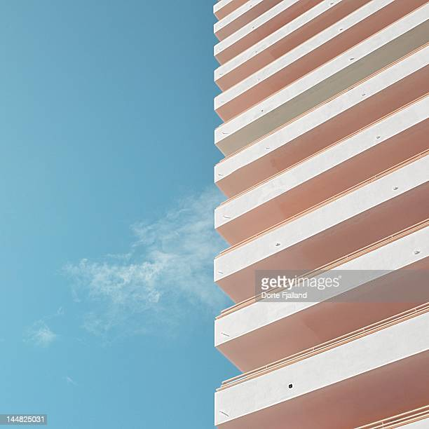 Blue sky, thin white cloud and white building