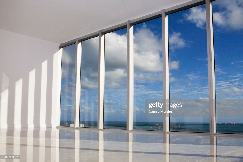 Blue sky viewed through windows in modern apartment : Foto stock