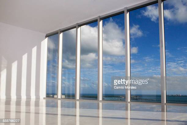Blue sky viewed through windows in modern apartment