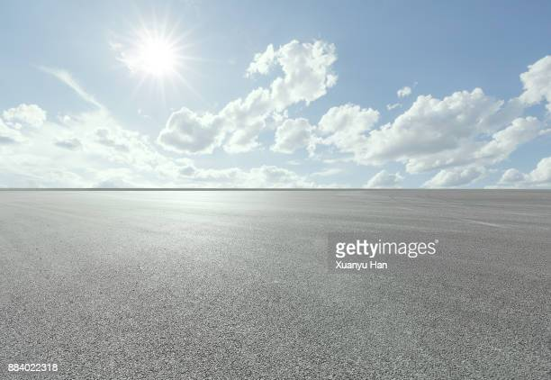 blue sky - white clouds - road - professional use auto advertising backplate. - horizon over land stock photos and pictures