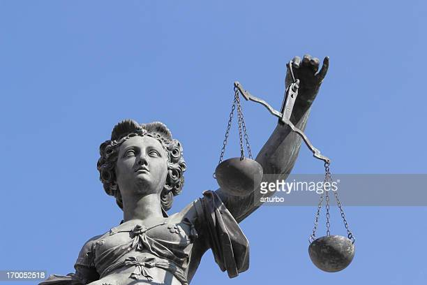 blue sky with ancient lady justice justitia - lady justice stock pictures, royalty-free photos & images