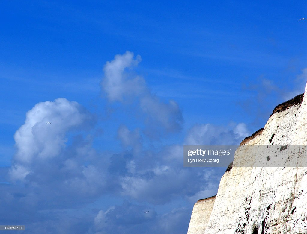Blue sky with chalk cliff : Stock Photo