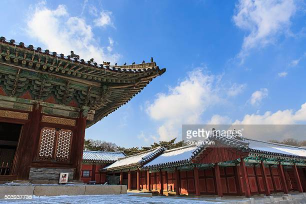 Blue sky with cloud over the Changgyeonggung Palace covered with snow, Seoul, Korea.