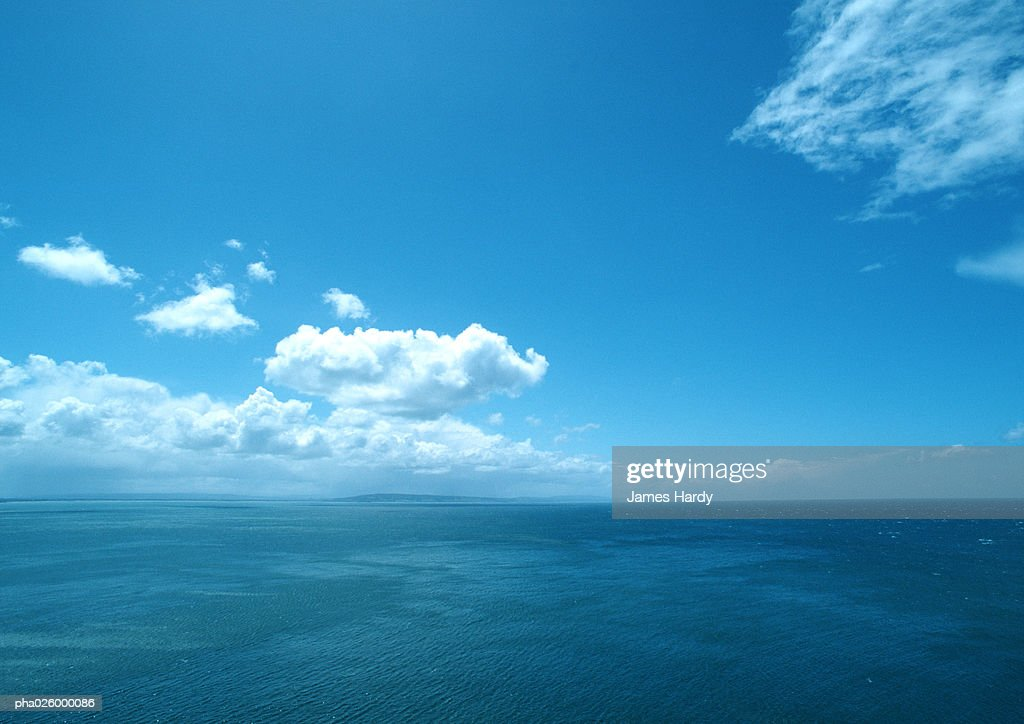 Blue sky with clouds and seascape. : Stockfoto