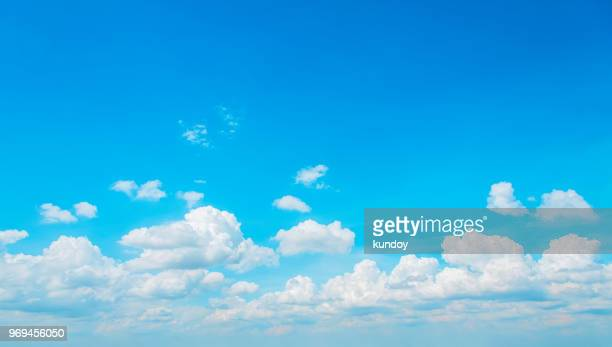 blue sky with fluffy clouds in summer season. - nuvens fofas imagens e fotografias de stock