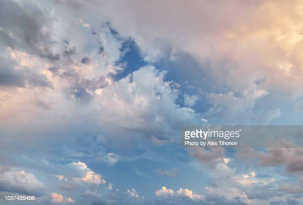 blue sky with fluffy clouds - overcast stock pictures, royalty-free photos & images