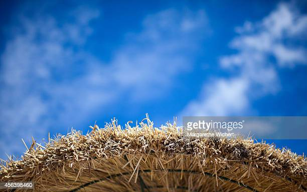 Blue sky with little clouds is seen above a parasol on May 31, 2013 near Manacor, Spain.