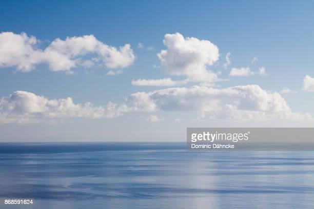 blue sky with ocean - dähncke fotografías e imágenes de stock