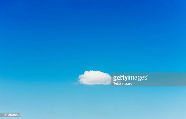 Blue sky with single cloud
