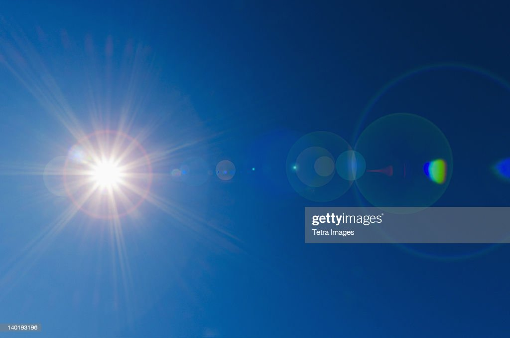 Blue sky with solar flare : Stock-Foto