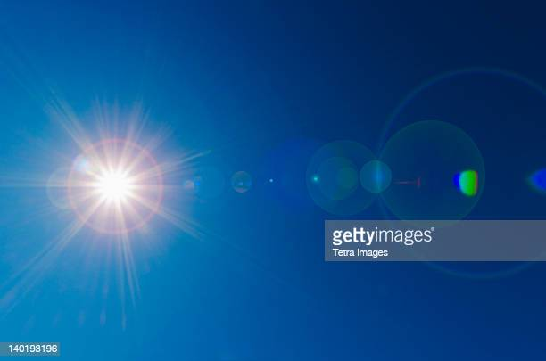 blue sky with solar flare - riflesso foto e immagini stock