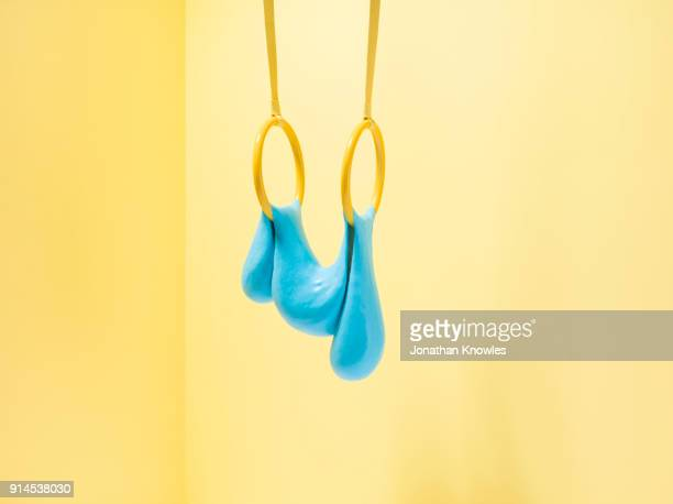 blue slime on gymnastic rings - slimy stock pictures, royalty-free photos & images