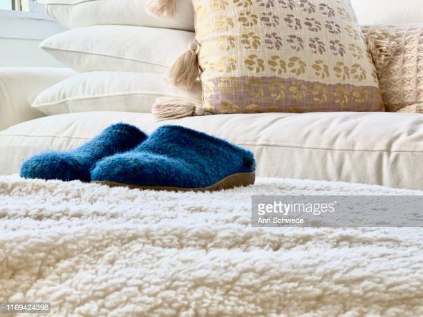 blue slippers in cozy white space - hygge stock pictures, royalty-free photos & images