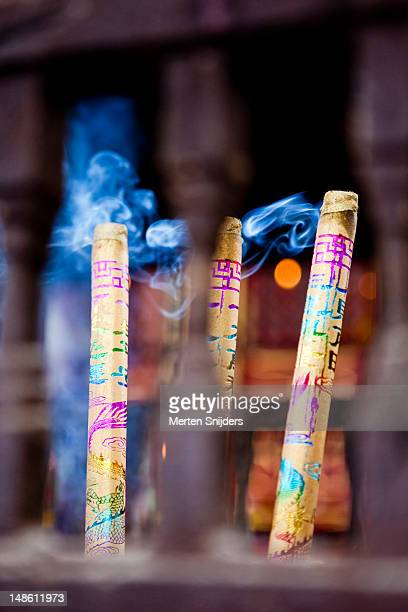 blue smoke from incense in temple on houhai beiyan road. - merten snijders stockfoto's en -beelden