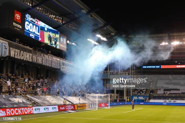 Blue smoke rises from behind the goal after Sporting Kansas City defender Winston Reid scored a goal in the second half of an MLS match between the...