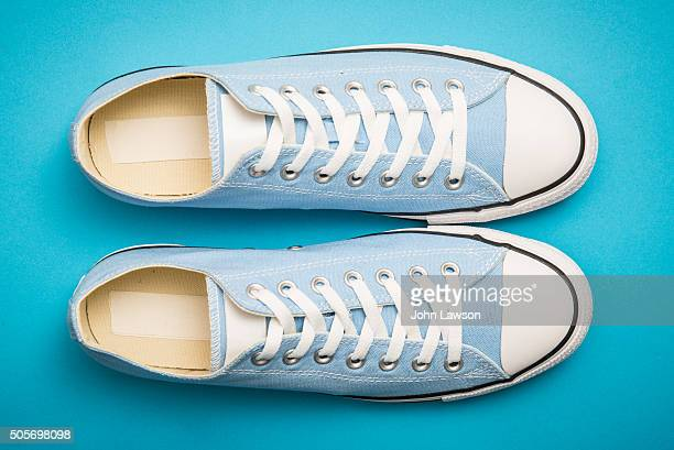 Blue sneakers on a blue background