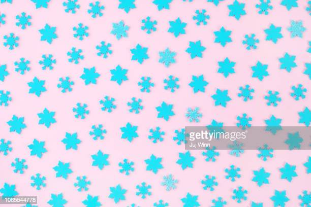 blue snowflakes on a pink background - snowflake stock pictures, royalty-free photos & images