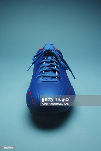 Blue soccer shoe