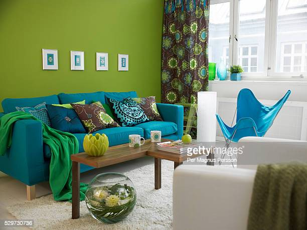 A blue sofa in a living room