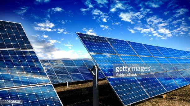blue solar panels - solar energy stock pictures, royalty-free photos & images