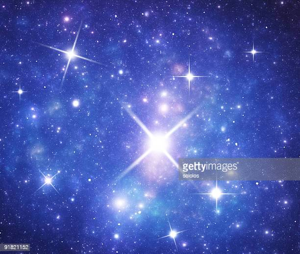 blue space galaxy with flares - flare stack stock photos and pictures