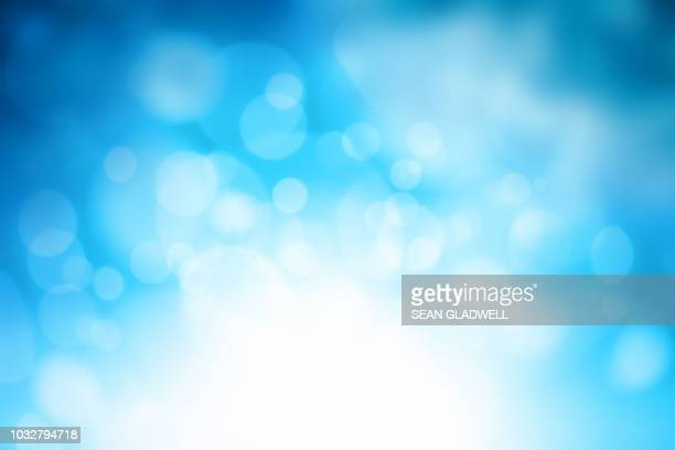 blue sparkle blur background - muted backgrounds stock pictures, royalty-free photos & images