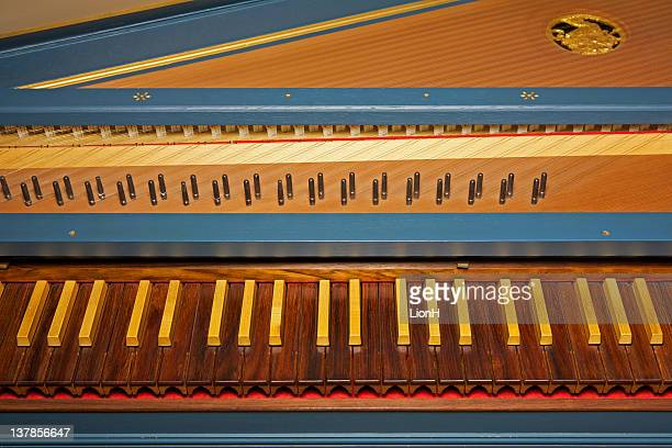 Blue spinet (harpsichord) with brown wooden keyboard