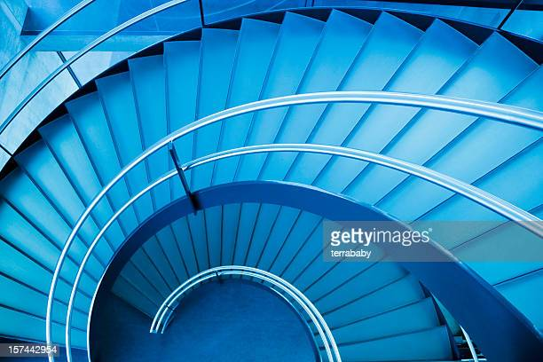 A blue spiral staircase seen from above