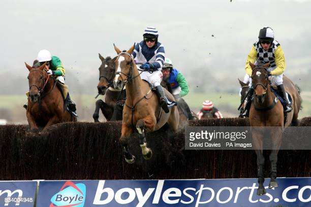 Blue Splash ridden by Paddy Merrigan and Without A Doubt ridden by Noel Fehily jump the fence in the Boylesportscom Cashback Steeple Chase