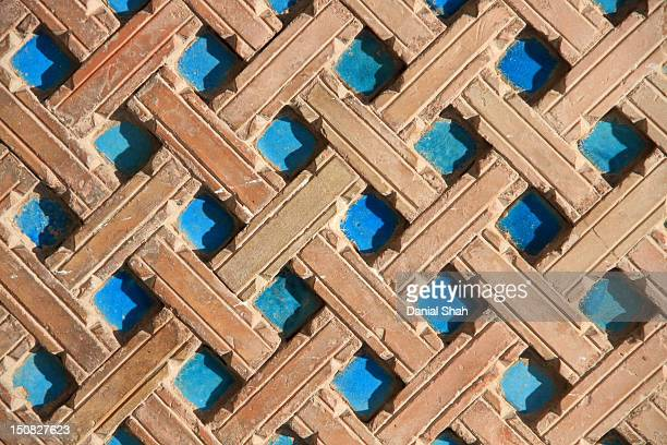 blue square tiles with brown lining - multan stock photos and pictures