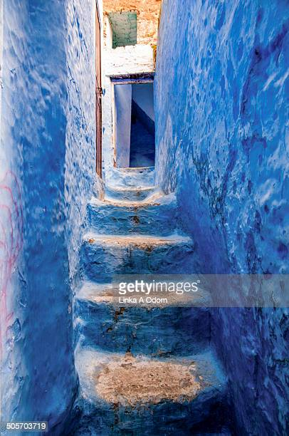 Blue stairwell up to a doorway