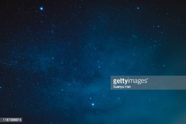 blue starry sky - night stock pictures, royalty-free photos & images