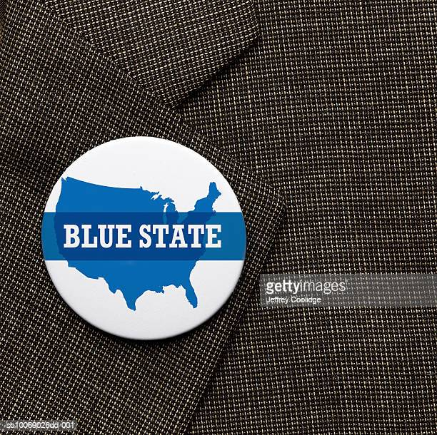 Blue State election button on jacket, close-up